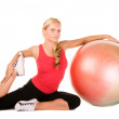 Woman exercising with a pilates ball — Stock Photo #1953795