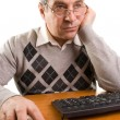 Senior man with computer — Stock Photo