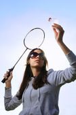 Young woman with badminton racquet — Stock Photo