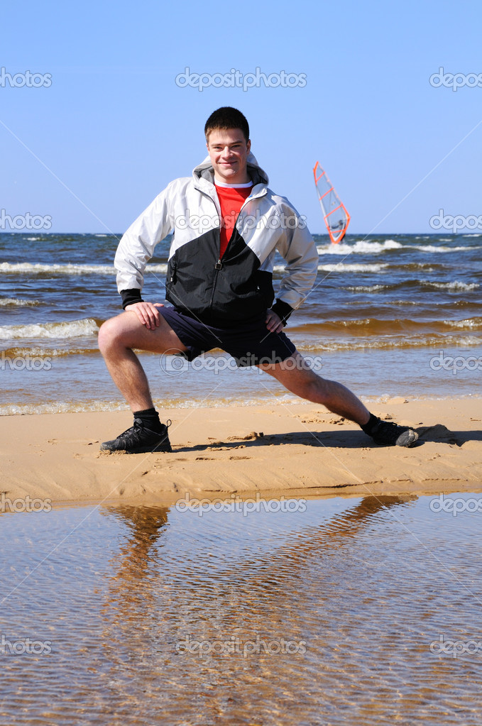 Young man doing exercise at beach — Stock Photo #1953176