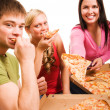 Friends having fun and eating pizza — Stock Photo #1968126