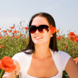 Young beautiful woman in poppy flowers — Stock Photo #1969338