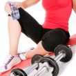 Stock Photo: Young beautiful girl at the gym