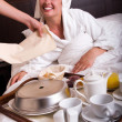 Beautiful woman with breakfast in bed — Stock Photo