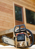 Chainsaw on wood cuttings (Shallow DOF) — Stock Photo