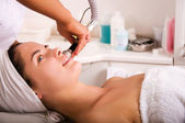 Young woman getting skin cleaning — Stock Photo