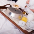 Woman with breakfast in bed — Stock Photo #1970025