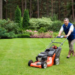 Senior man mowing the lawn. — Stock Photo #1970762