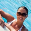 Стоковое фото: Beautiful young woman at a pool