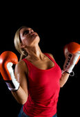 Boxer girl over black background — Стоковое фото