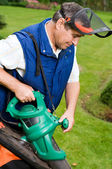 Man with leaf blower — Stock Photo