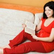 Stock Photo: Pregnant woman sitting on the couch