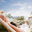 Stock Photo: Young woman in hammock