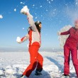 Two girls playing with snow — Stockfoto