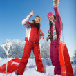 Two young beautiful girls with sledges — Stock Photo #1988966