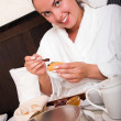 Beautiful woman with breakfast in bed — Stock Photo #1989702