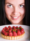 Woman with raspberry cake — Stock Photo