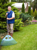 Man raking garden — Stock Photo