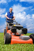 Senior man mowing the lawn. — Stock Photo
