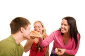 Friends are having fun and eating pizza — Stock Photo