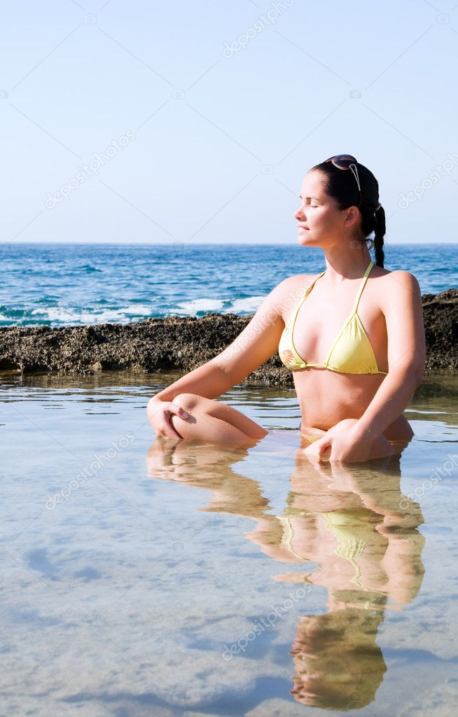 Beautiful young woman doing yoga at the sea  Stock Photo #1987523
