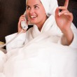 Woman talking on phone in bed — Stock Photo #1990333