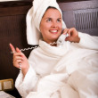 Woman talking on phone in bed — Stock Photo #1990362