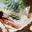 Stock Photo: Young womin hammock