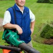 Man with leaf blower — Stock Photo #1990547