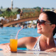 Stok fotoğraf: Beautiful young woman at a pool