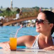 Stockfoto: Beautiful young woman at a pool