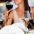 Beautiful woman tasting red wine — Stock Photo