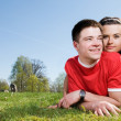 A happy couple on a green meadow — Stock Photo
