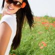 Young beautiful woman in poppy flowers — Stock Photo #1990878