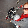 Beautiful woman on the motorcycle — Stock Photo