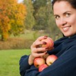 Stock Photo: Beautiful girl in the garden with apples