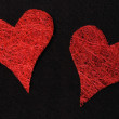 Two red hearts on black background — Stock Photo