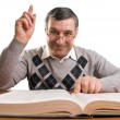 Senior man with book (isolated on white) — Stock Photo