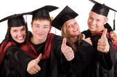 Group of happy graduated students — Stock Photo