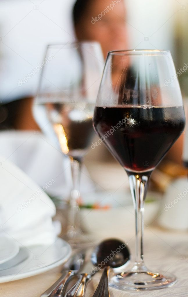 The served table with red wine at restaurant (shallow dof) — Stock Photo #1990663
