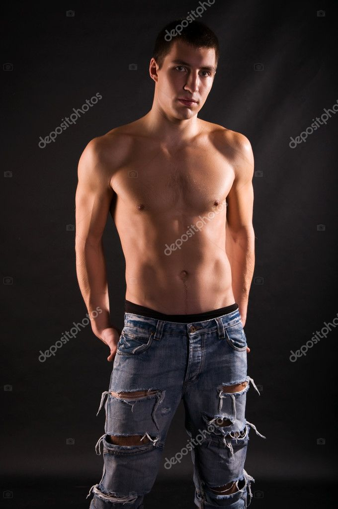 Dramatic light photo of muscular young man in front of black background  — Stock Photo #1991591