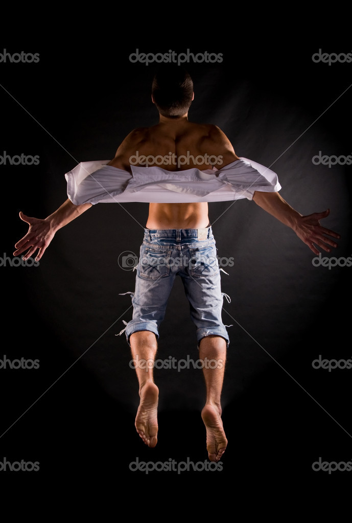 Dramatic light photo of modern acrobat jumping in front of black background  — Stock Photo #1991602