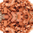 Heap of red brick isolated — Stock Photo