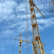 Two crane towers on sky background — Stock Photo #1746385