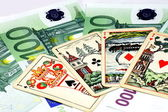 Euros banknote with playing card — Stock Photo