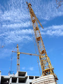 Two crane towers on sky background — Stock Photo