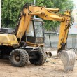 Stock Photo: Wheeled excavator on ground