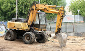 Wheeled excavator on ground — Stock Photo