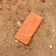 One brick on sand — Stock Photo #1844318