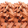 Heap of red brick isolated - Stock Photo